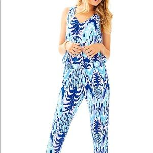 0e0feefa6c74 Silver Loose fitting Romper also available in plum.  M 5944006bf739bcb6b202fcf7. Other Pants you may like. Lilly Pulitzer  Paulina Jumpsuit